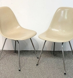 28. Two Charles & Ray Eames Shell Chairs | $123