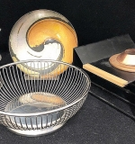 118. Five Pieces of Metalware | $82.60