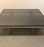 395. Modernist Steel and Smoked Glass Coffee Table |  $687.50