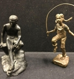 425. Two Bronze Figures: Girl Jumping Rope; Male Nude |  $75