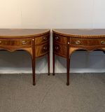 460. Pair of Baker Demilune Console Cabinets |  $1,875
