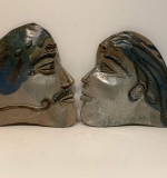 514. Two Art Pottery Face Plaques |  $12