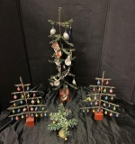 522. Lot of Four Decorated Christmas Trees |  $570