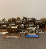563. Nine Assorted Horse Trophies |  $406.25