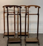 107. Four Carved Mahogany Valet Stands |  $562.50