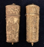 122. Two Gold Wash Repousse Sewing Cases |  $270