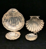 188. 4 Pcs. Shell-form Sterling: 3 Trays; Ashtray |  $100