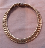 219. 18K Yellow Gold Cartier Basket-Weave Necklace |  $5,520