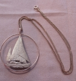 223. 14K Sailboat Necklace on 20in. Curb Link Chain |  $570