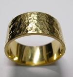 249. 18K Yellow Gold Hammered-finish Band Ring |  $420