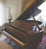 Steinway & Sons Baby-grand Piano with Carved Figured-Mahogany Bench. $9,680