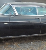 1958 Cadillac Series 62 Coupe. $18,880