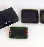Four Cartier, Paris dark-green jade cigarette accessories. $35,400