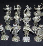Set of 12 silver musicians with jeweled accents. $7,080