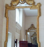 Pr. monumental early 19th C. Louis XVI-style giltwood & gesso mirrors. $14,750