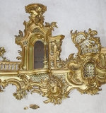Ornate Rococo-form giltwood carved wall shelf with mirror. $5,566