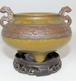 Chinese pottery censor with dragon-form handles on a pierced wood stand. $5,808