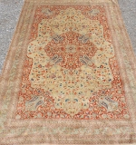 Silk room-size carpet with central medallion design. $37,760