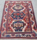 Caucasian area-size carpet with three medallions. $7,260