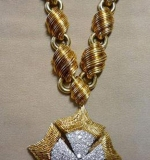 David Webb 18K yellow gold necklace with diamond-encrusted fur pin/pendant. $31,050