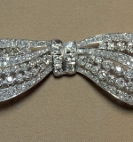 Stunning diamond-encrusted bow pin set in platinum. $4,598