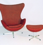 Arne Jacobsen Egg Chair and Ottoman with red upholstery. $3,540