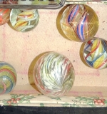 6 vintage glass swirl-design shooter marbles. $948