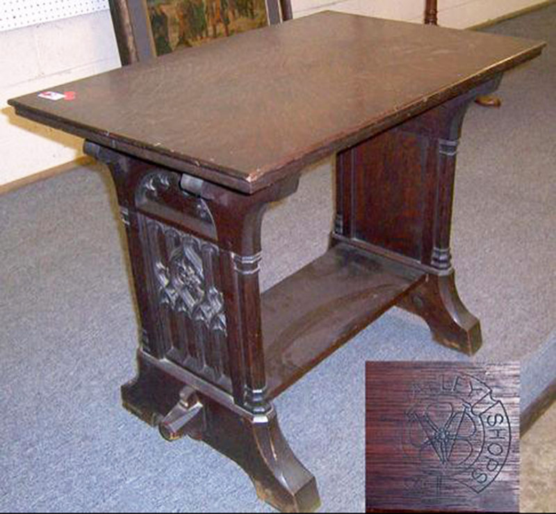 Rose Valley Carved Oak Trestle Table. $28,750
