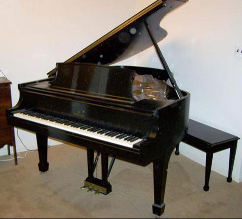 Steinway & Sons Baby-grand Piano in Black-laquered case. $10,800
