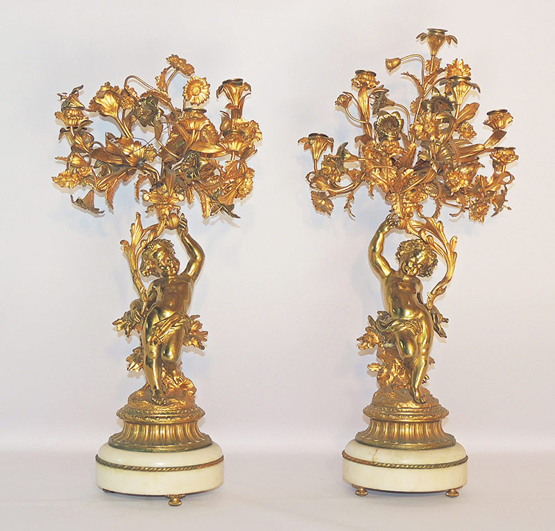 Pr. Louis XVI-Style Gilt Candelabra with cherub supports, on marble bases. $2,360