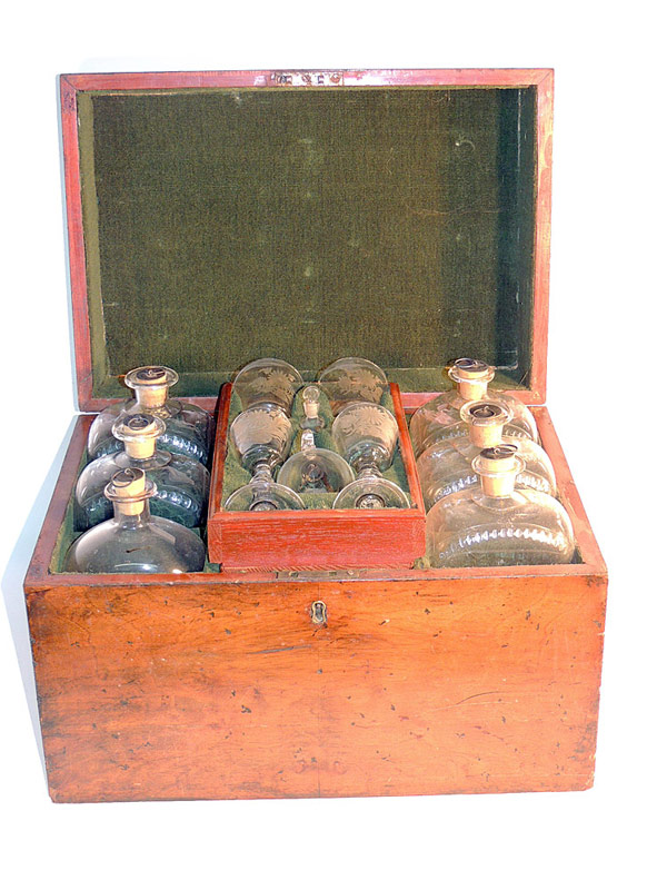 Mahogany Bottle Case, circa 1800, with fitted interior, bottles and glasses. $2,360