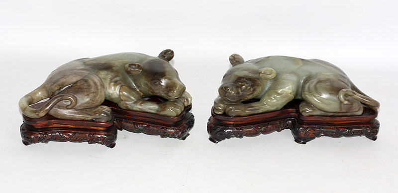 Pair of Chinese carved hardstone reclining animals on fitted teak stands. $5,900