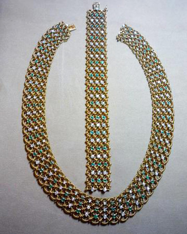 Diamond and emerald necklace and bracelet set in 18k yellow gold. $23,600