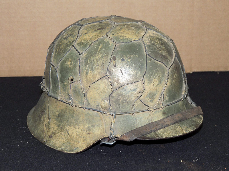 German WWII wire-wrapped Helmet with leather liner. $8,050