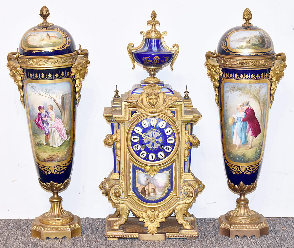 31. Sevres Gilt Bronze and Porcelain Clock Garniture. $1,003