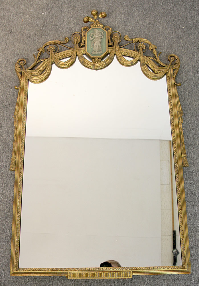 102. Neoclassical-style Parcel Gilt Mirror. $236
