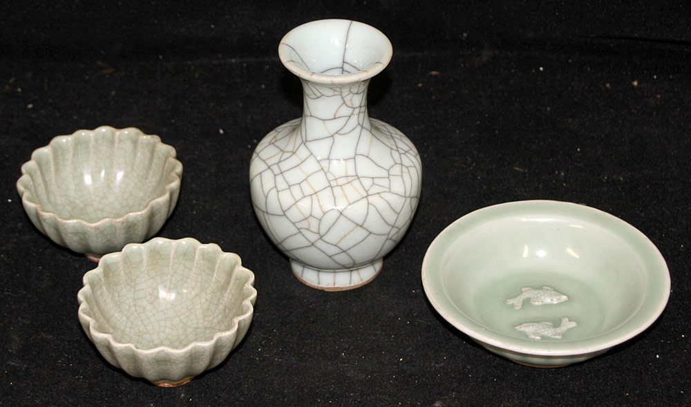 122. Four Pieces of Chinese Celadon Porcelain. $461.25