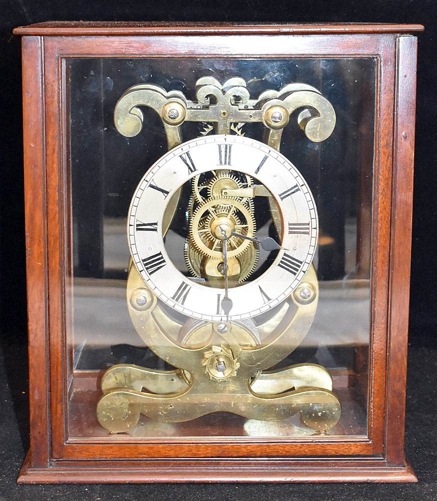 200. Lyre-form Brass Skeleton Shelf Clock. $501.50