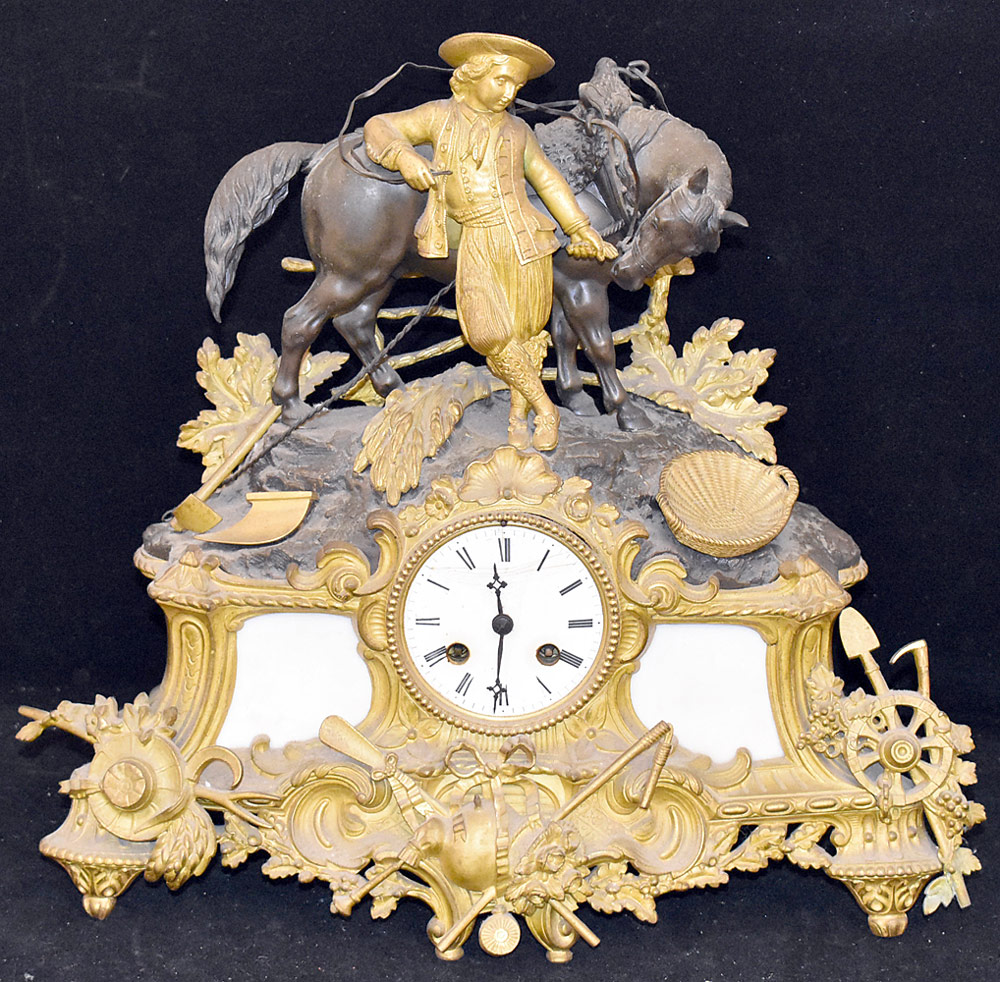 208. French Gilt and Patinated Bronze Mantel Clock. $307.50
