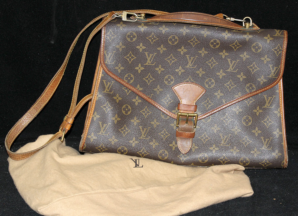 255. Louis Vuitton Envelope-style Bag. $206.50