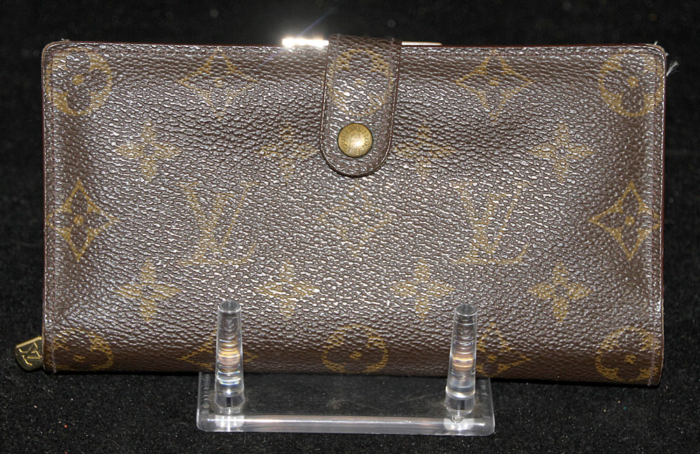 256. Louis Vuitton Leather Wallet. $265.50