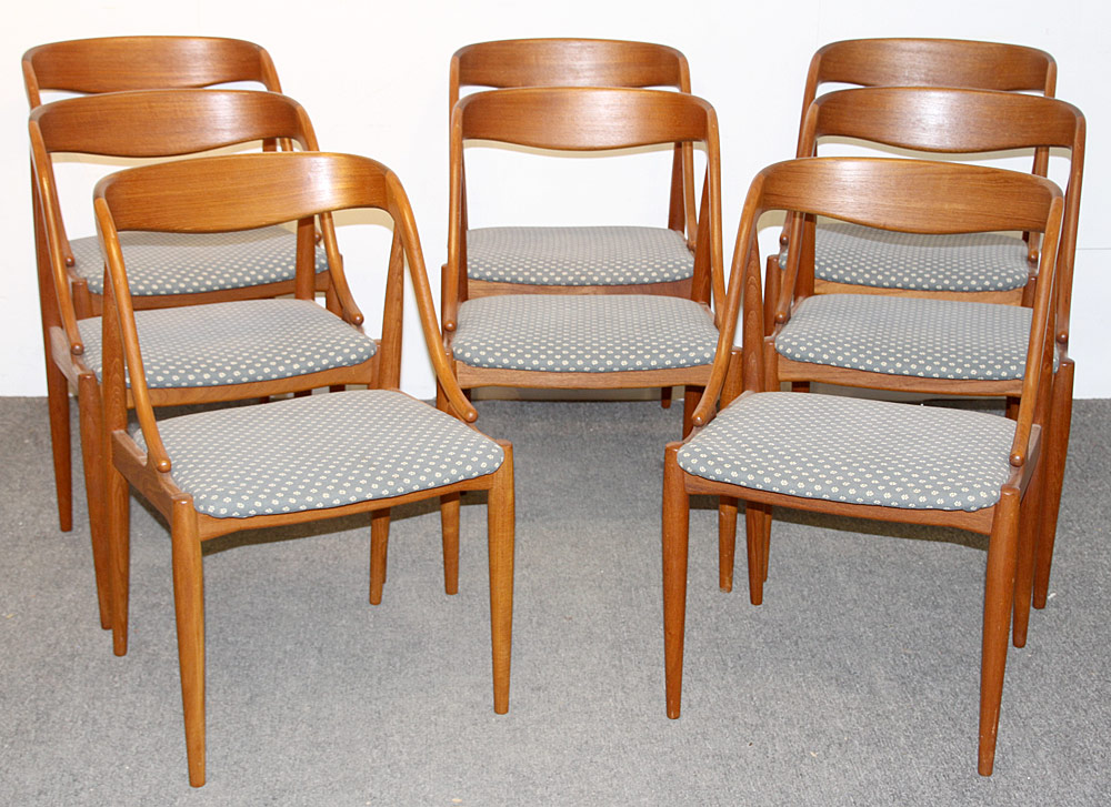 363. Eight Moreddi Danish Teak Dining Chairs. $2,091