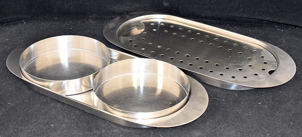 181. Two Arne Jacobsen Serving Platters. $153.75