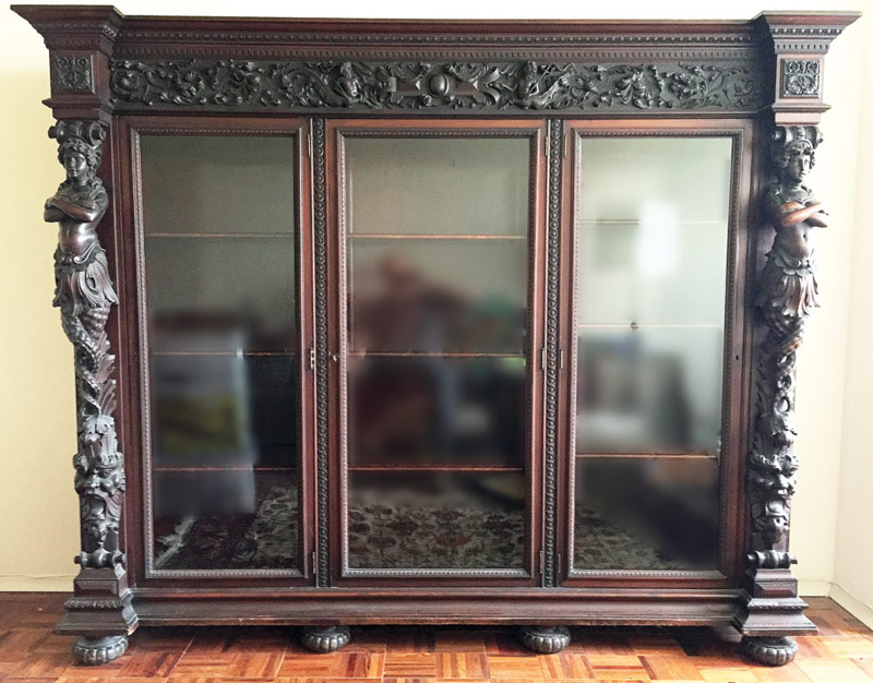 R.J. Horner 3-door Carved Mahogany Bookcase. $15,340