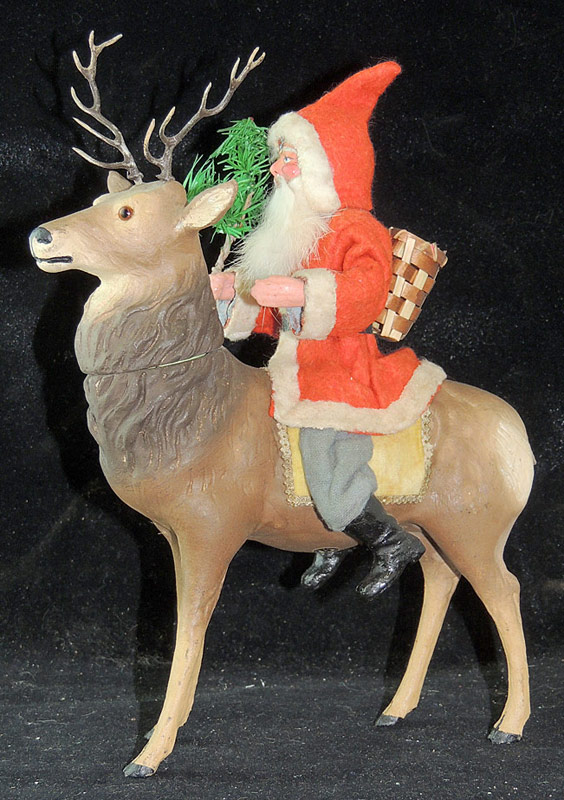 Composition Santa on Reindeer Candy Container. $3,776