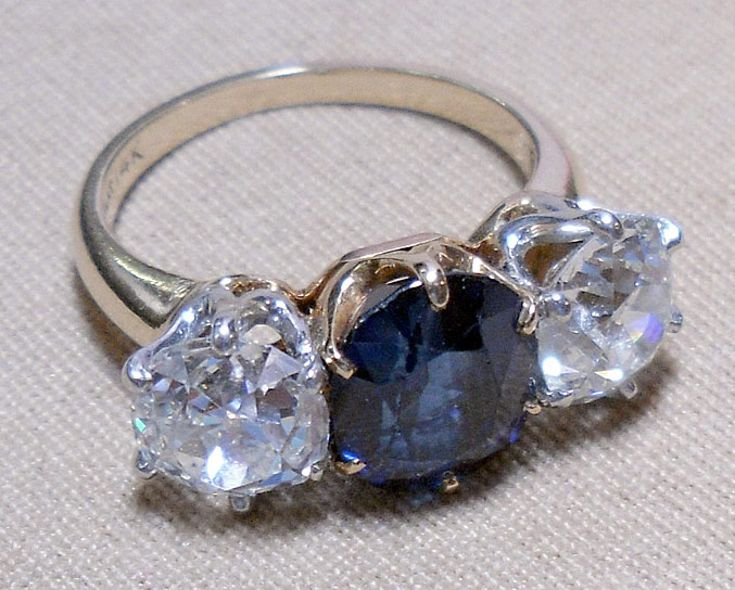 14K Diamond and Sapphire Ring. $17,700