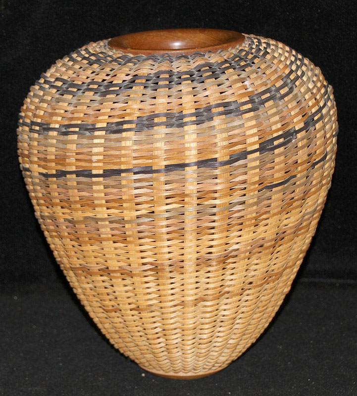 106. Tom and Connie McColley. Woven Basket | $123