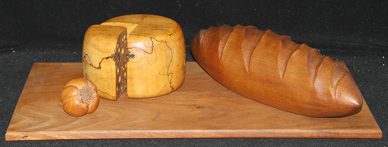 107. Michelle Holzapfel. Mixed-Wood Bread & Cheese Board | $649