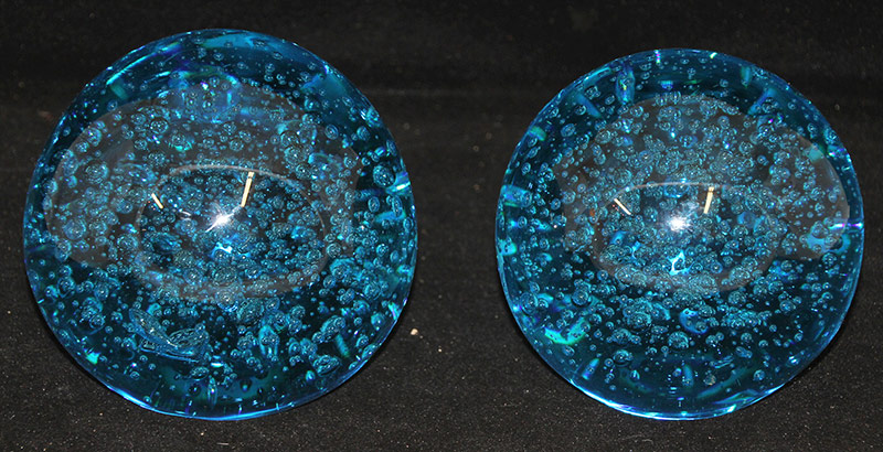 111. Pair of Large Blue Glass Orb Sculptures | $472