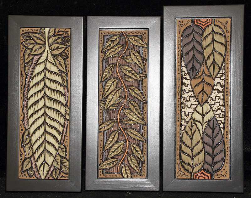 113. Three Deb Leair Carved/Painted Pottery Plaques | $118